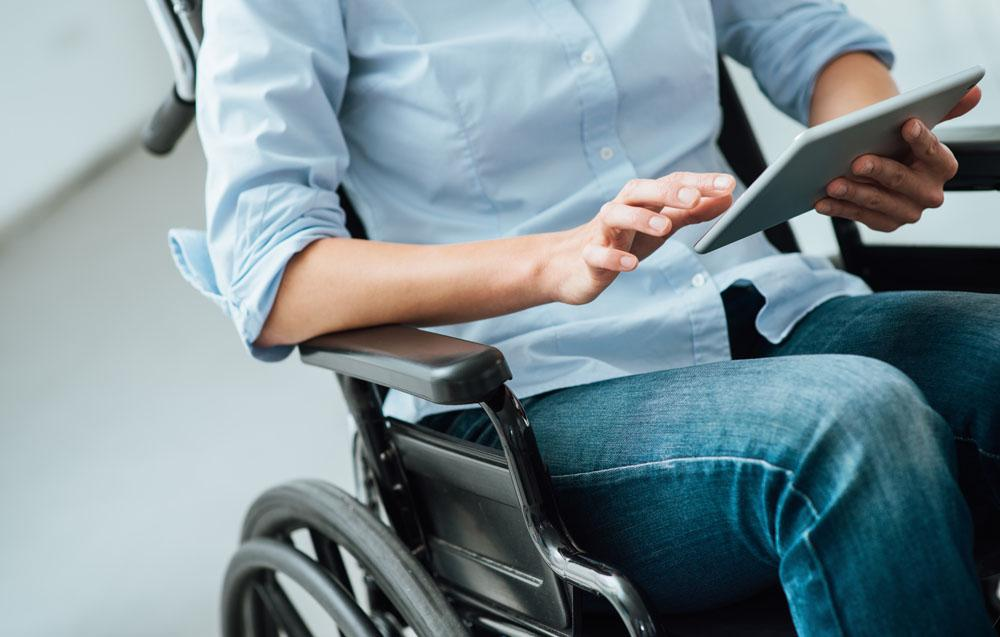 Woman-in-wheelchair-using-a-tablet-498907122_7360x4912.jpg